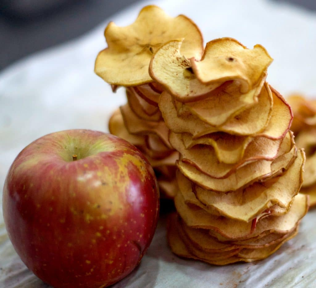 Easy to make and delicious! The oven does the hard work. Make these Apple Chips recipe at home, kid friendly and customizable. Love the crunchy spicy chips. More back to school recipes at livingsweetmoments.com