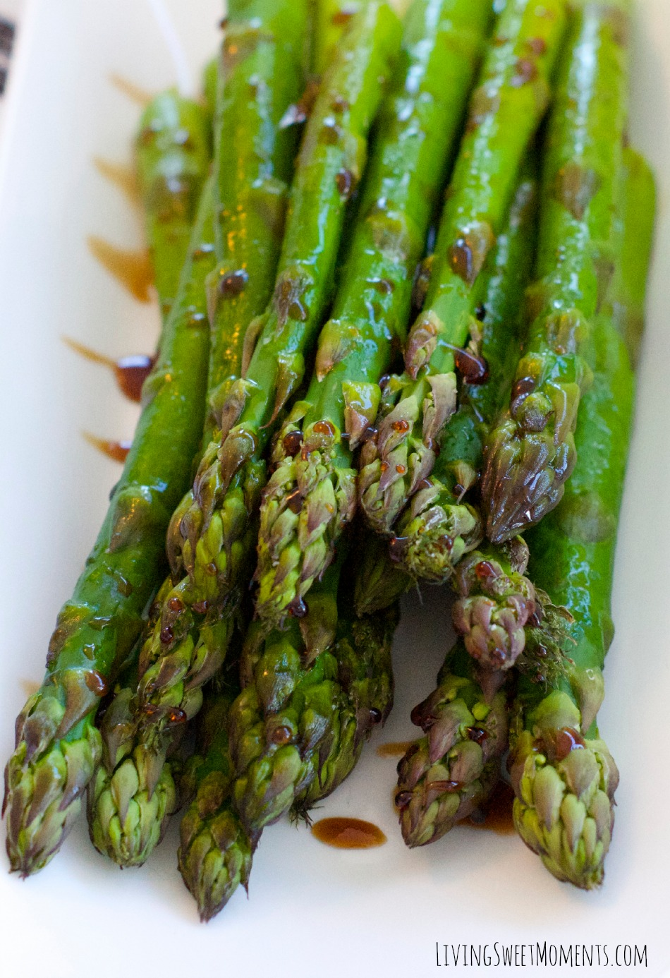 This delicious Lemon Balsamic Asparagus Recipe is perfect for a quick and healthy side dish weeknight meal. It's tangy, sweet and very flavorful.
