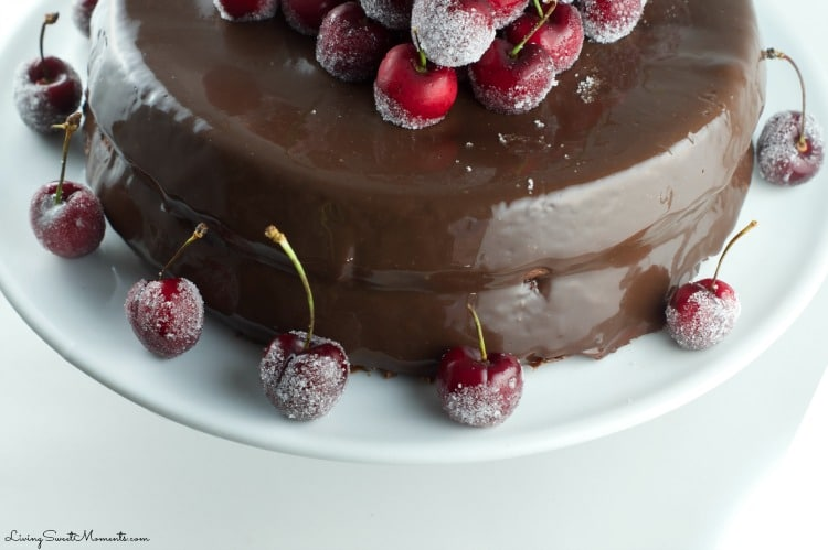 This spectacular Chocolate Cake Recipe with frosted cherries will not disappoint. The cake is chocolate with chocolate ganache and some snowed cherries. Yum