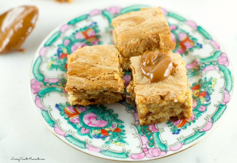 Brown Butter Blondies With Dulce De Leche - so delicious and irresistible. Butterscoth blondies with a creamy dulce de leche center. The perfect decadent dessert.