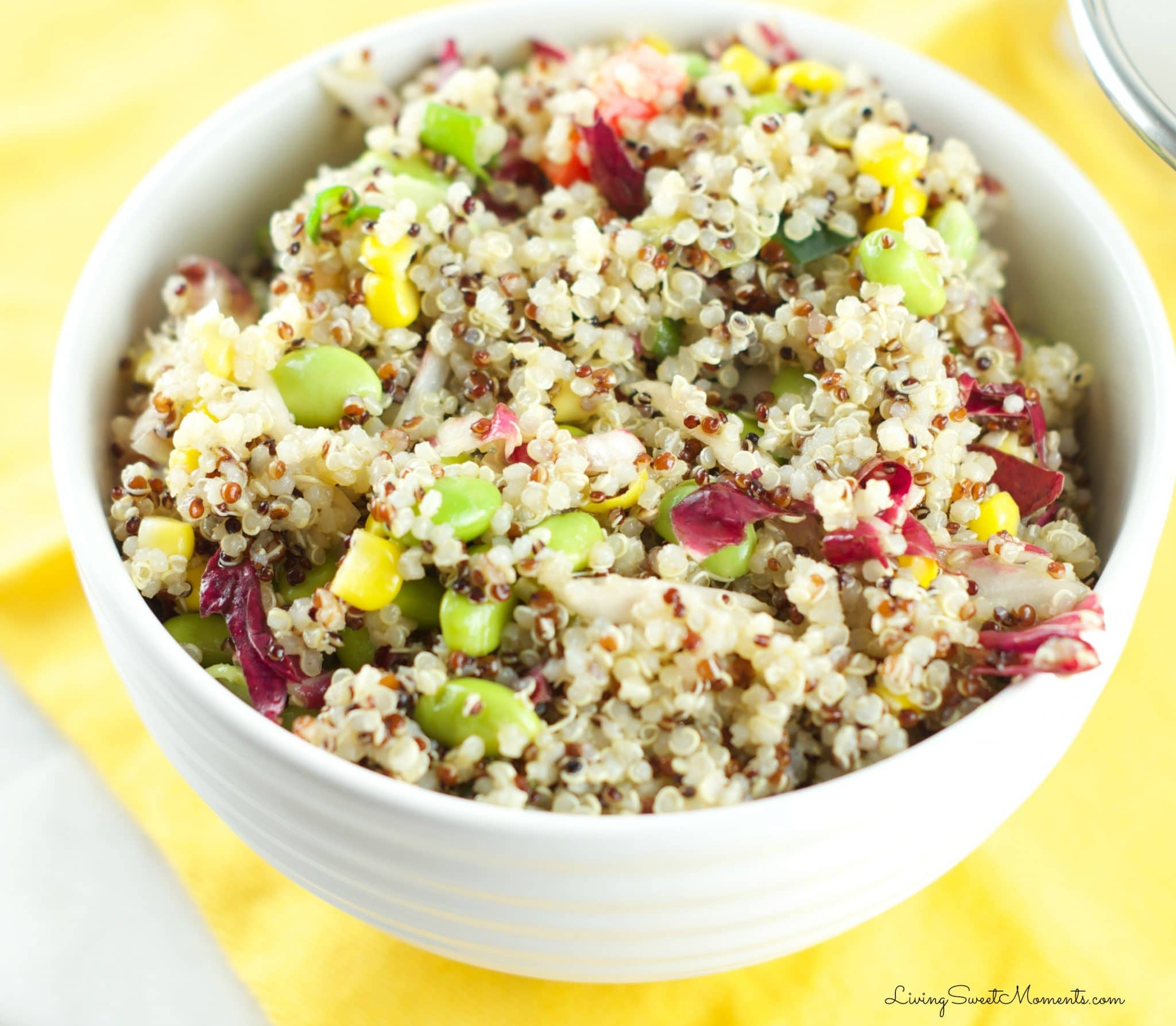 This fresh Quinoa Edamame Salad Recipe is colorful, crunchy and delicious. Served with an Asian-inspired vinaigrette and lots of veggies. Low fat and tasty