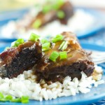 asian style short ribs - made in the slow cooker. Super easy to prepare and a delicious weeknight dinner recipe. The short ribs are fall off the bone tender