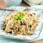 Coca Cola Rice Recipe : This delicious latin rice made with coca cola is topped with raisins and toasted almonds. Great and easy side dish to any meal. Yum!
