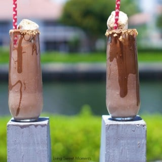 s'mores shakes - Delicious Chocolate shakes with marshmallows and graham crackers topped with toasted marshmallows. Perfect for summer outdoor entertaining.