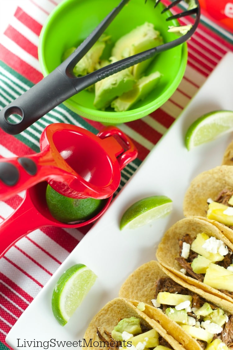 Tacos Al Pastor - These easy beef tacos al pastor are made in the slow cooker. Shredded beef topped with pineapple chunks, cheese and avocados. Delicious!