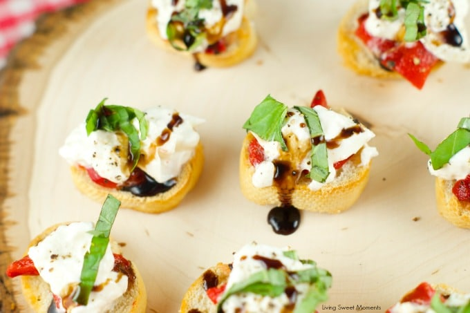 Roasted Red Pepper Burrata Crostini - crispy baguette slices are topped with roasted red peppers, creamy burrata, basil and a splash of balsamic glaze.