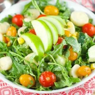 Apple And Tomato Arugula Salad: delicious summer salad with tomatoes, arugula, corn, apple and hearts of palm tossed with a homemade Mustard Vinaigrette.