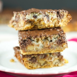 Hello Dolly Bars: these magic bars are made a graham cracker crust, chocolate chips, walnuts, cereal, coconut and more. Perfect dessert for any holiday or get together!