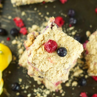 Lemon Creme Crumb Bars: Crumbly butter oatmeal crust with a citrus berry creme filling. These bars are the perfect summer dessert for any occasion