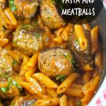One Pan Pasta And Meatballs: the perfect one pot meal dinner idea! Tender homemade meatballs are cooked inside a tomato basil sauce served with penne pasta.