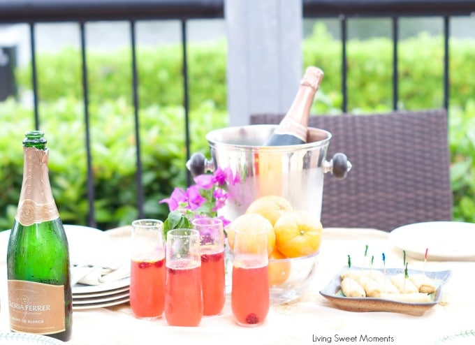Orange raspberry sparkling wine cocktail: the ultimate summer cocktail! Combine cointreau with raspberry sorbet, fresh raspberries in a bubbly delicious drink.