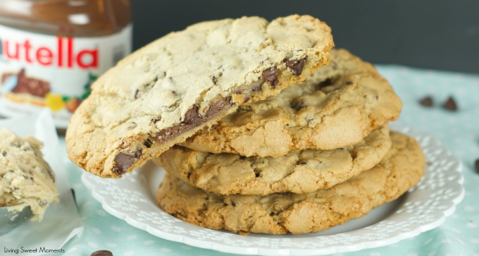 Nutella Stuffed Chocolate Chip Cookies - chewy chocolate chips cookies are filled with creamy Nutella. The perfect indulgent dessert for kids and adults. More on www.livingsweetmoments.com
