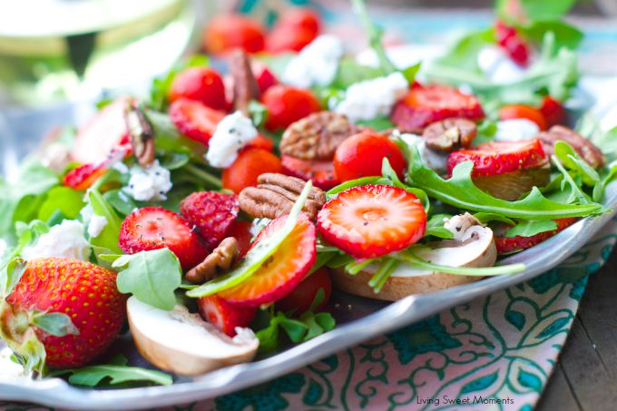 delicious Arugula salad topped with strawberries, goat cheese and toasted pecans then drizzled with a simple vinaigrette