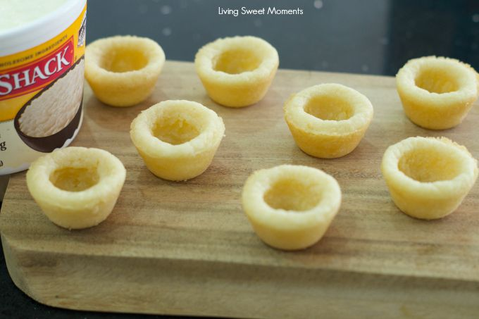 Bananas Foster Cookie Cups- chewy cookie cups filled with rice pudding and topped with homemade bananas foster. An easy to make dessert for any occasion