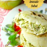 Delicious Venezuelan Arepas filled with the best avocado chicken salad. Perfect for a quick lunch and dinner! Use it in sandwiches, arepas or by itself! Yum
