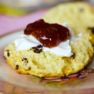 Classic English Scones - this british dessert is made with currants in a delicate pastry that's perfect for tea time. Top them with clotted cream and jam. More on www.livingsweetmoments.com