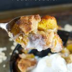 Skillet Peach Cobbler: This easy dessert recipe is delicious, easy and whips up in minutes. Peaches are cooked first on the stove and then baked in the oven