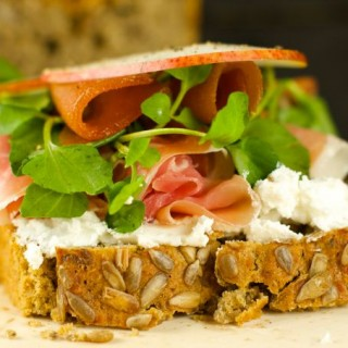 Open Faced Ham And Cheese Sandwich - delicious sandwich with goat cheese, pears, guava, watercress and ham topped with sweet honey. Easy, elegant and tasty!