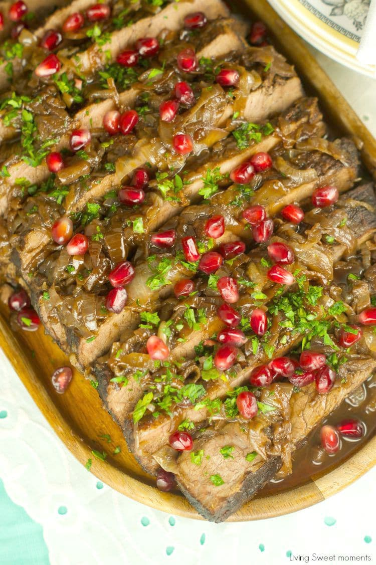 Wine And Pomegranate Brisket Recipe: delicious braised brisket with a pomegranate and wine sauce. Perfect & easy beef dinner for parties and entertaining.