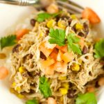 Slow Cooker Chicken And Black Beans - Delicious chicken is slow cooked in beans, corn, salsa verde and spices. Enjoy over rice or as a burrito bowl. Perfect weeknight dinner idea!