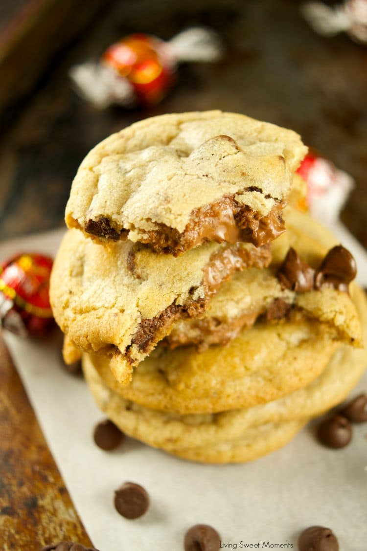 Truffle Stuffed Chocolate Chip Cookies - these chewy chocolate chip cookies are ooey gooey and stuffed with a chocolate truffle. The best cookie recipe! Yum