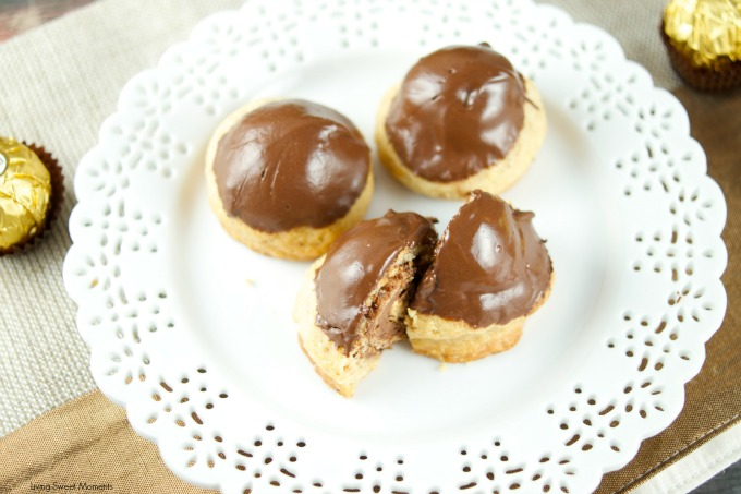 This Ferrero stuffed hazelnut cookies are topped with melted chocolate. The perfect crispy cookie recipe that will wow a crowd. Best dessert ever! Yum