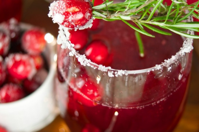 This delicious Holiday Cranberry Mocktail is infused with rosemary and cranberry syrup. Topped with a fizzy lime soda! The perfect drink for Holiday parties