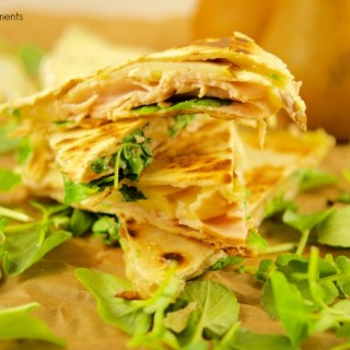 These delicious Turkey Brie Quesadillas have a touch of pear and are perfect for a quick weeknight dinner idea under 10 minutes or as a party appetizer. Yummy!!