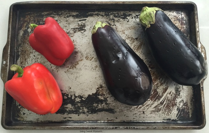 This delicious roasted red pepper Baba Ghanoush recipe is made with roasted eggplants and peppers. Makes a savory and smoky spread for bread, pitas, etc.