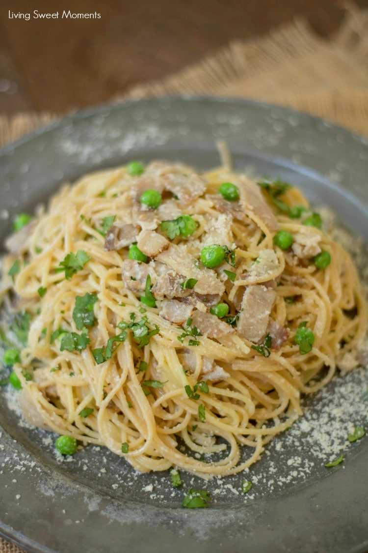 This delicious Spaghetti Carbonara Recipe made with peas, is easy to make and is ready in 20 minutes or less. The perfect quick weeknight dinner idea.