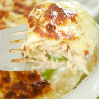This easy & delicious Salmon Lasagna Recipe is made with flaky salmon and asparagus. Then is baked in a dilly Bechamel sauce. Perfect for weeknight dinner.