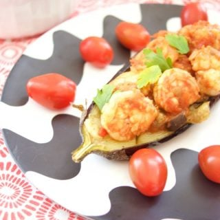 This delicious Shrimp Stuffed Eggplant Recipe is easy to make and is perfect for a nice weeknight dinner idea. The filling is inspired by Italian Caponata