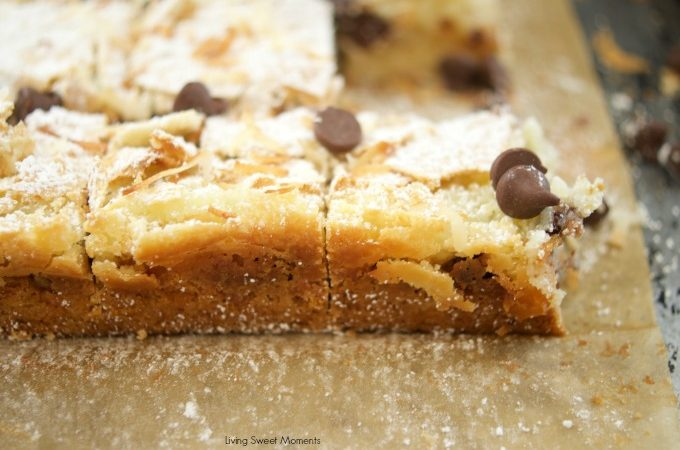 This delicious St. Louis Gooey Butter Cake Recipe is easy to make and has chocolate and coconut in the middle for extra flavor. The perfect summer dessert!