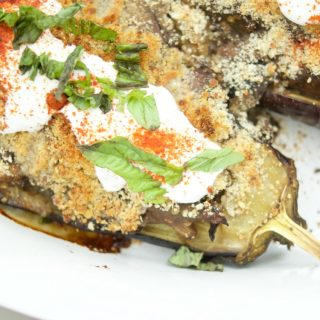 This tasty Eggplant Stuffed with Mushrooms recipe is super easy to make and the perfect vegetarian entree for the summer. Topped with a savory crust.