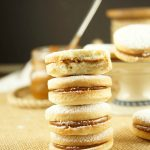 Alfajores Recipe - they are delicate shortbread cookies filled with dulce de leche. These cookies use cornstarch as a main ingredient. Great with coffee!