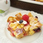 This delicious Overnight French Toast Casserole recipe is stuffed with maple peanut butter and berries. Perfect for brunch, breakfast, or even dessert. Yum!
