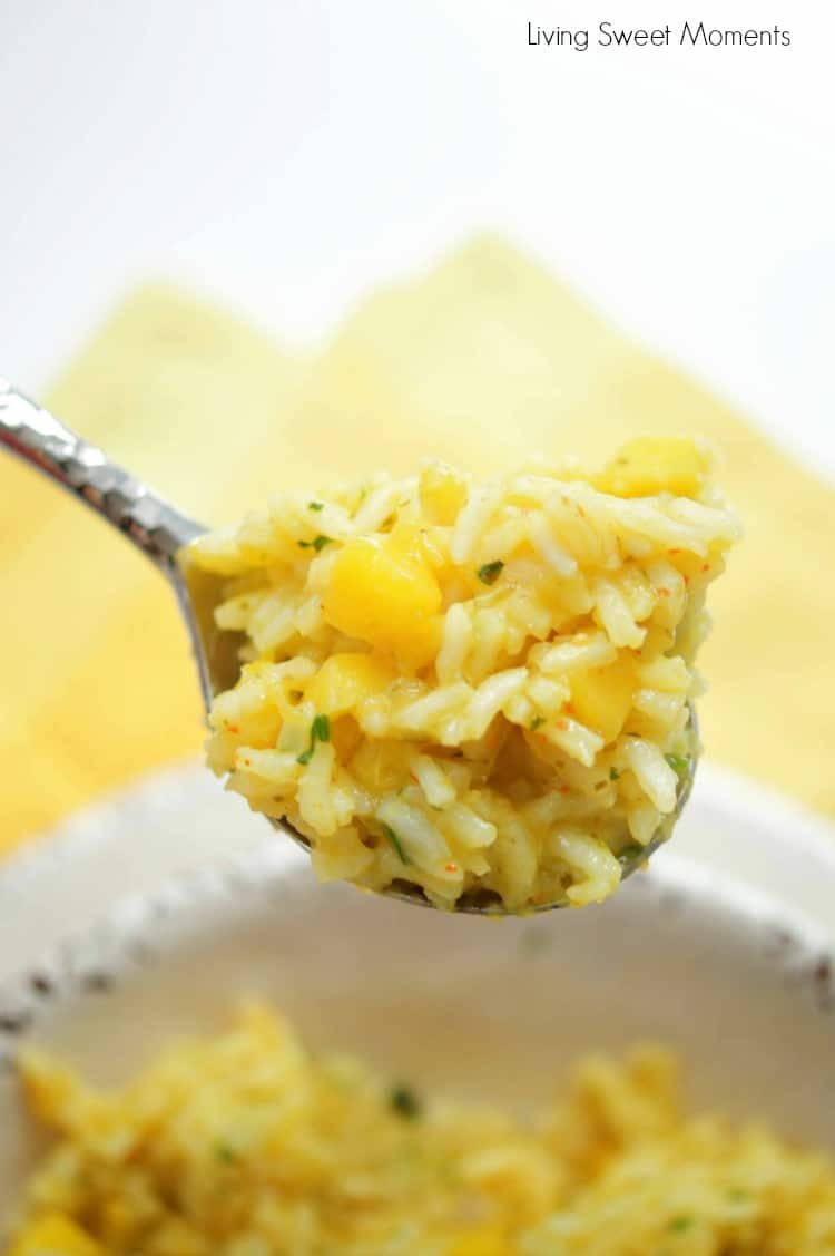 This Spicy Mango Rice recipe is easy to make and delicious. The perfect side dish to any dinner or for entertaining. Made with chili, cilantro, lime & mango