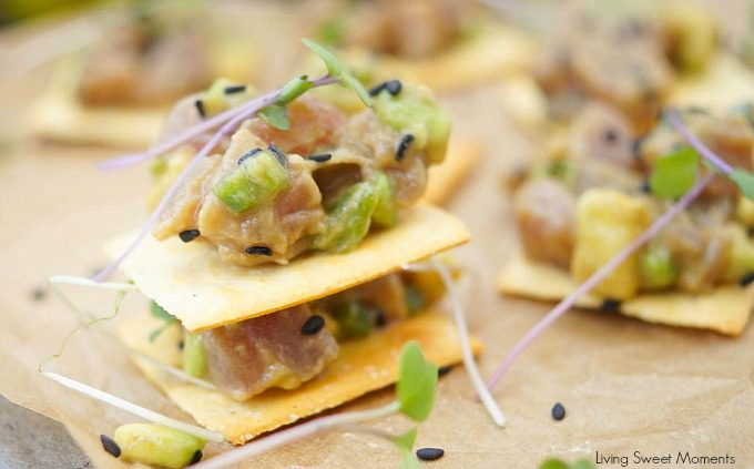 This delicious tuna tartare recipe is made with avocado and dressed in an Asian sauce. The perfect healthy appetizer served on top of a cracker.