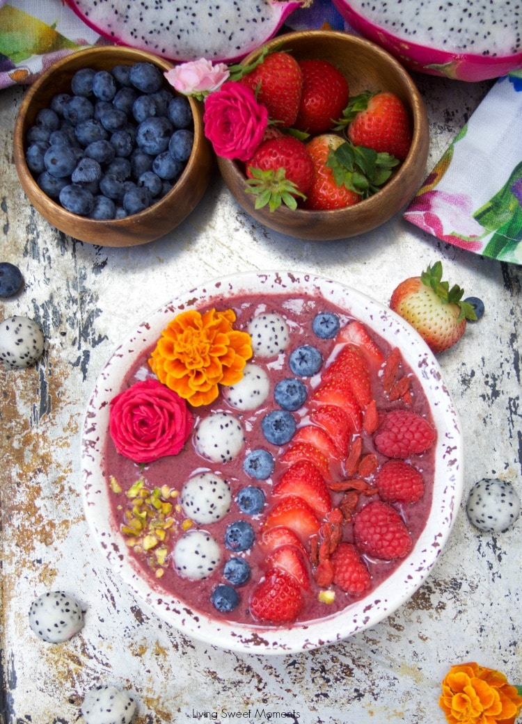 This delicious acai bowl recipe is blended with berries, dragonfruit, and yogurt. It's topped with fresh fruit and nuts. A healthy and quick breakfast idea.
