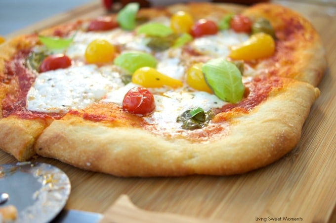 This delicious burrata pizza recipe is made with homemade pizza dough and is topped with sauce, summer tomatoes, and burrata cheese. Great for entertaining!