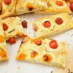 This delicious focaccia recipe is made under an hour and is flavored with cherry tomatoes and rosemary. It makes a wonderful appetizer to parties or dinners