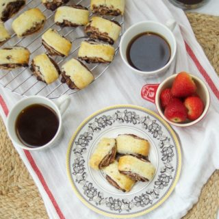 This Chocolate Espresso Rugelach recipe is super easy to make & delicious. Enjoy buttery cookies filled with a yummy chocolate filling. Perfect for parties.