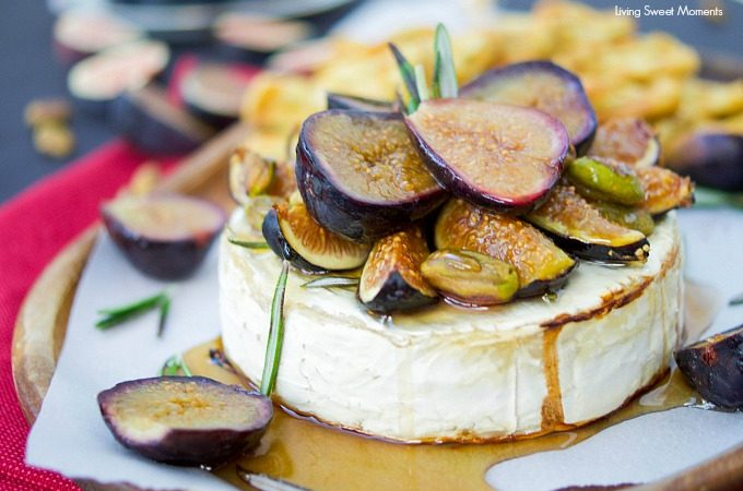 This delicious baked brie recipe is topped with roasted figs, honey, rosemary, and pistachios. The perfect easy appetizer that's ready in 25 minutes or less