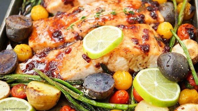 This delicious & easy Salmon Sheet Pan Dinner recipe is made in 30 minutes or less and has a sweet tangy sauce. Served with potatoes, asparagus, & tomatoes.