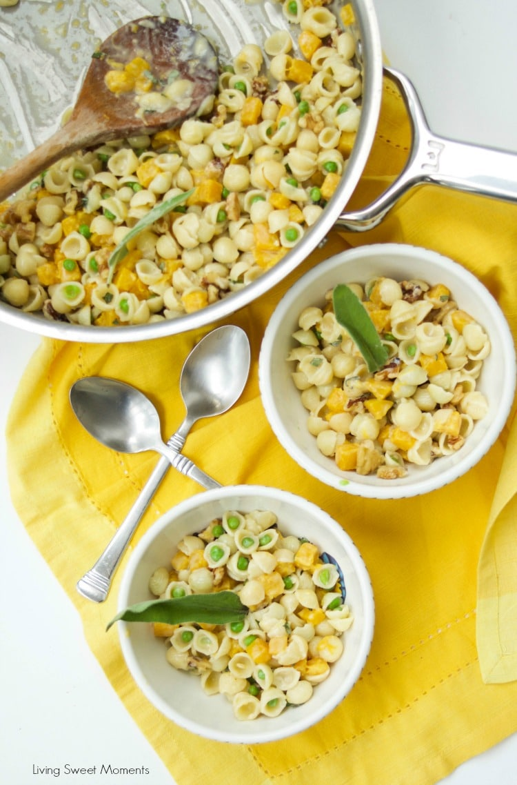 This creamy Mac And Cheese recipe is inspired by fall featuring butternut squash, peas, sage, and walnuts. The perfect easy 30-minute weeknight dinner idea. Vegetarian too!