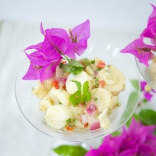 This Hearts Of Palm Ceviche recipe is the perfect vegan appetizer that you can whip up in 10 minutes or less. Enjoy the fresh citrusy flavors with avocado.