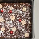 These soft and chewy Peppermint Blondies are covered in chocolate and sprinkled with candy. The perfect Holiday dessert recipe for parties and celebrations.