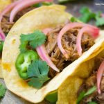 This scrumptious beef barbacoa tacos recipe is made quickly in the pressure cooker and served with homemade pickled onions. Perfect for dinner and parties.
