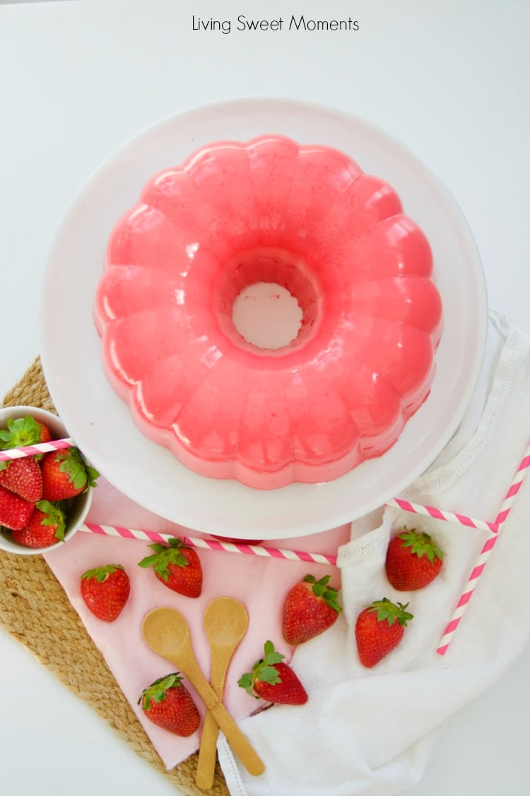 This decadent strawberry Flan Jello Cake Recipe is a 3 in 1. A Cake and flan encased in a refreshing jello shell. A showstopper dessert for any occasion.