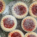 These delicious and tangy Strawberry Rhubarb Tarts are super easy to make and are the perfect mini desserts for any party. Top them with powdered sugar.